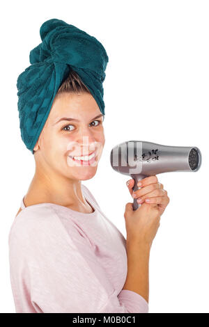 Smiling young woman holding a blow dryer after bath on isolated background - Stock Photo