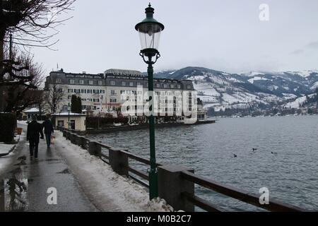 Zell am See, Austria – January 1, 2018: Lakeside promenade and noble historic Grand Hotel on Lake Zeller See, in - Stock Photo