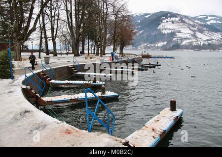 Lakeside promenade and noble historic Grand Hotel on Lake Zeller See, in winter. Austria, Europe. - Stock Photo