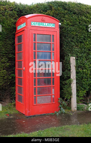 January 2018 - Old classic red telephone box now being used to house a defibrillator, the village of  Meade, Somerset, - Stock Photo