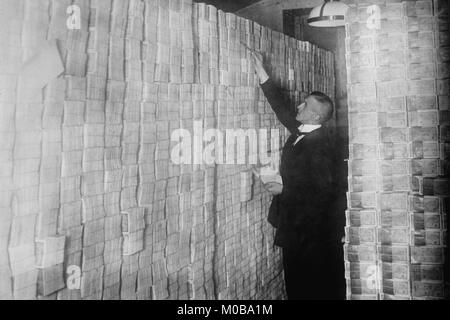 Inflation in Weimar Germany has paper money stacked from Floor to Ceiling in a Berlin Bank - Stock Photo