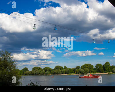 Red rescue boat on a river in Germany and the cable car - Stock Photo