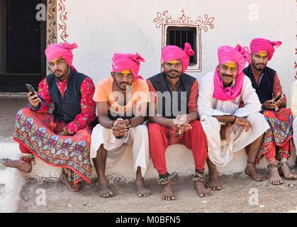 Rajasthani folk musicians relaxing, Udaipur, India - Stock Photo