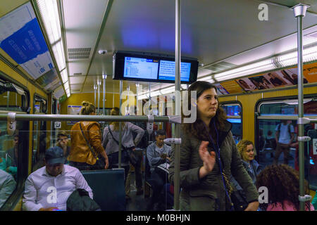 Munich, Germany - October 14, 2017: The interior of the subway car with passengers - Stock Photo