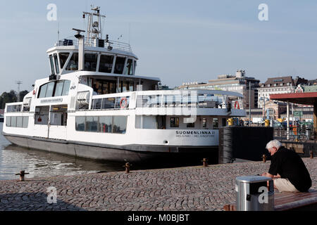 Helsinki, Finland - August 21, 2016: People on the ferry to Suomenlinna moored at the Market square. Suomenlinna - Stock Photo