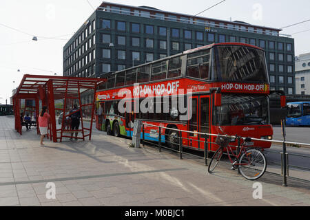 Helsinki, Finland - August 21, 2016: Tourists in the sightseeing tour bus in the city center. Hop-On Hop-Off buses - Stock Photo