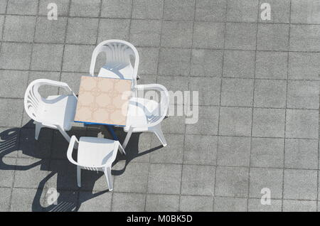 Table with White Plastic Chairs from Above - Stock Photo