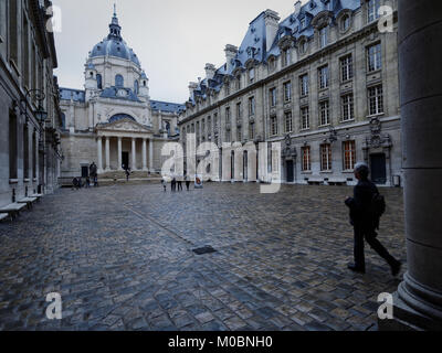 Paris, France - September 14, 2013: People in the courtyard of Sorbonne against the Sainte Ursule chapel. The chapel - Stock Photo