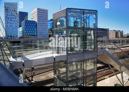 OSLO, NORWAY – AUGUST 17, 2016: View of Akrobaten pedestrian bridge  with modern business architecture and elevator - Stock Photo