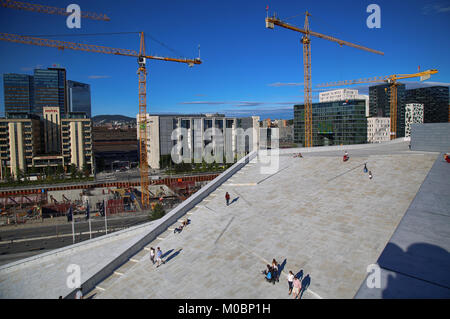 OSLO, NORWAY – AUGUST 17, 2016: View on Bjorvika and tourist on the Oslo Opera House which is home of Norwegian - Stock Photo