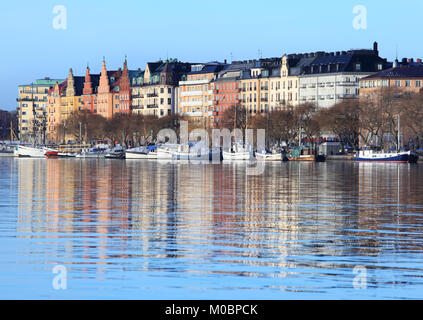 Stockholm, Sweden - January 5, 2012: Boats moored at the embankment in a winter day. Stockholm archipelago is the - Stock Photo