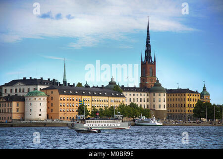 STOCKHOLM, SWEDEN - AUGUST 20, 2016: Tourists boat and View of Gamla Stan from Stockholm City Hall ( Stadshuset - Stock Photo