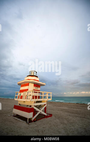 Lonely lifeguard tower on empty beach on a cloudy afternoon in Miami, Florida - Stock Photo