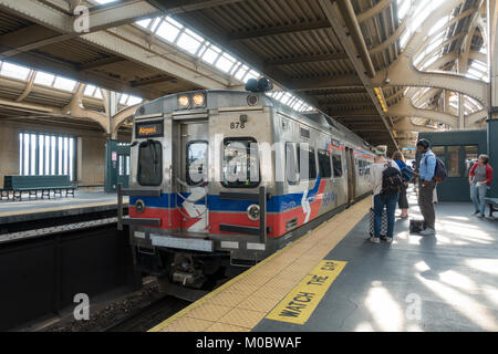 An Airport bound SEPTA train arriving at 30th Street station, the main railroad station in Philadelphia, Pennsylvania, - Stock Photo