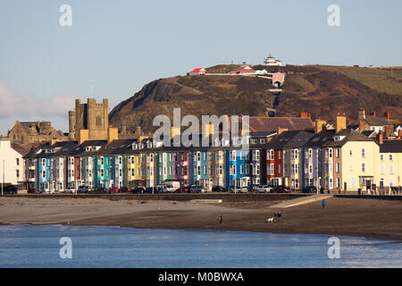Town of Aberystwyth, Wales. Picturesque view of brightly coloured house facades on the esplanade front at South - Stock Photo