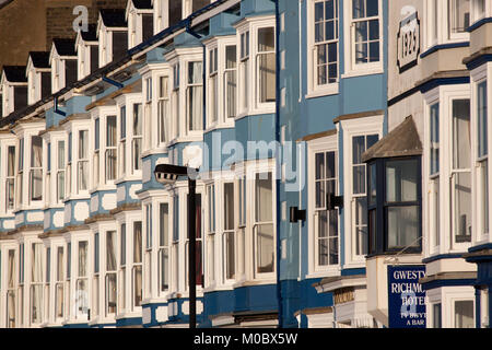 Town of Aberystwyth, Wales. Picturesque view of the brightly coloured house facades, on Aberystwyth's esplanade - Stock Photo