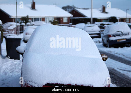 car parked on the street windscreen covered in snow in newtownabbey northern ireland - Stock Photo