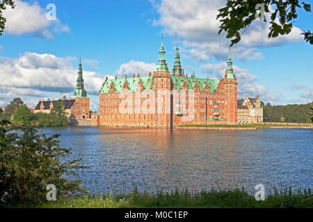 The Frederiksborg Castle in Dutch Renaissance style in Hillerød near Copenhagen, Denmark, in bright summer morning - Stock Photo