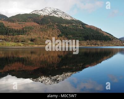 Snow capped Dodd reflected in Bassenthwaite Lake, Lake District Nationa Park, Cumbria, United Kingdom - Stock Photo