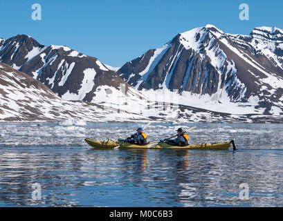 Kayaking in the arctic waters of Lillhook Fjord on the archipelago of Svalbard, Norway - Stock Photo