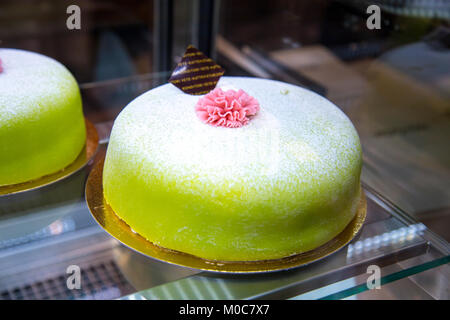 Green princess cake - traditional Swedish layer cake consisting of alternating layers of sponge cake, pastry cream - Stock Photo