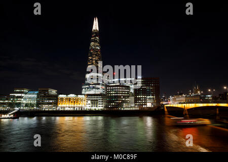 The Shard & London Bridge at night. - Stock Photo