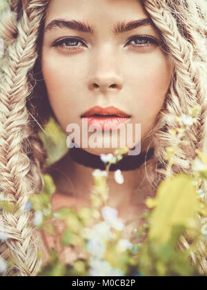 Outdoor fashion portrait of beautiful blonde young girl with pigtails hairstyle. Spring-Summer vibes. Warm autumn. - Stock Photo