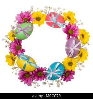Colorful wreath of Easter eggs and flowers isolated on white background. - Stock Photo