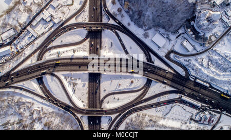 Aerial view of a turbine road interchange in Kiev. Aerial Drone Flight View of freeway busy city rush hour heavy - Stock Photo