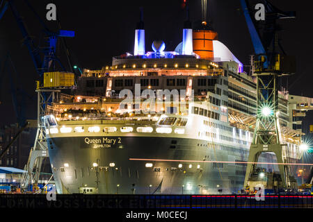 Queen Mary 2 in Hamburg harbor at the dock of Blohm and Voss - Stock Photo