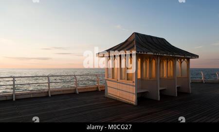 Sheltered seats on Cromer Pier, Norfolk, UK - Stock Photo