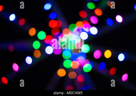 Abstract multicoloured Christmas lights on poles - Stock Photo