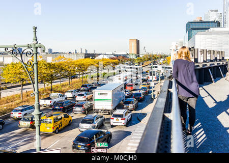 New York City, USA - October 27, 2017: View of Hudson River from highline, high line, urban in NYC with woman tourist - Stock Photo