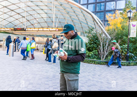 New York City, USA - October 27, 2017: Man handing out Fresh&Co smartwater flyers by urban in NYC Chelsea West Side - Stock Photo
