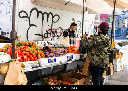 Bronx, USA - October 28, 2017: Cheap fruit stand food display market shop sale display in Fordham Heights center, - Stock Photo