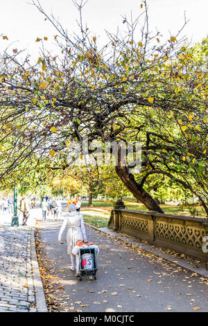 New York City, USA - October 28, 2017: Manhattan NYC Central park with artist woman person pantomime walking on - Stock Photo