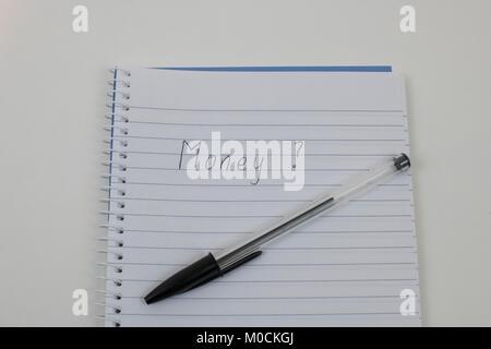 Handwriten Money on notepad - Stock Photo