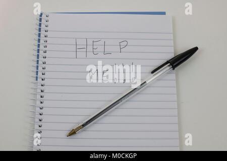 Handwriten HELP on notepad - Stock Photo