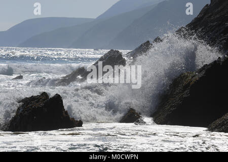 Waves crashing against the rocks and shoreline on dingle peninsula, county kerry, Wild Atlantic Way - Stock Photo