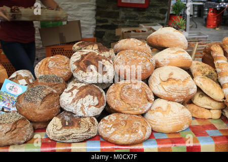 Various home baked breads for sale at a Farmers market in Ireland - Stock Photo