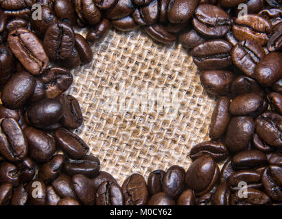 Roasted Coffee Beans on a Burlap Cloth Awaiting Your Words - Stock Photo