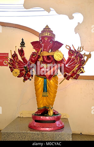 This is Number 4 of 32 miniature Ganesh statues in the circular hall under the large pink elephant building of Wat - Stock Photo