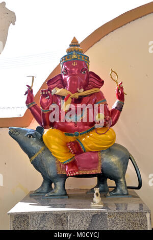 This is Number 13 of 32 miniature Ganesh statues in the circular hall under the large pink elephant building of - Stock Photo