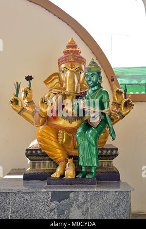 This is Number 16 of 32 miniature Ganesh statues in the circular hall under the large pink elephant building of - Stock Photo