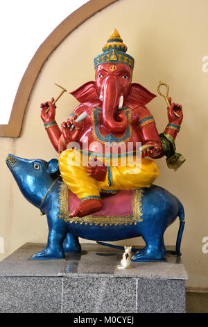 This is Number 23 of 32 miniature Ganesh statues in the circular hall under the large pink elephant building of - Stock Photo