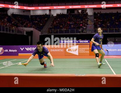 Kuala Lumpur, Malaysia. 21st Jan, 2018. Zheng Siwei (L) and Huang Yaqiong of China compete during the mixed doubles - Stock Photo