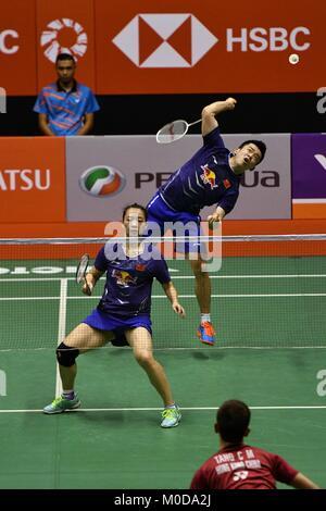 Kuala Lumpur, Malaysia. 21st Jan, 2018. Zheng Siwei (Back) and Huang Yaqiong of China compete during the mixed doubles - Stock Photo