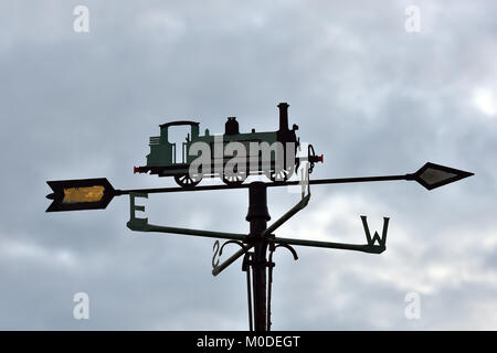 a metal weather vane in the form of a steam railway train or locomotive. A weather forecasting device monitoring - Stock Photo