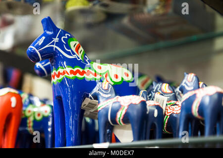 Blue Swedish Dala Horse on a shelf at a store - Stock Photo
