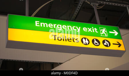 Emergency and toilets sign in an airport - Stock Photo